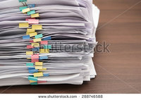 stock-photo-pile-of-documents-with-colorful-clips-on-desk-stack-up-288746588 (1)